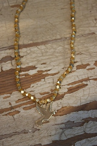 Ettika Gold Ribbon Necklace with Dove